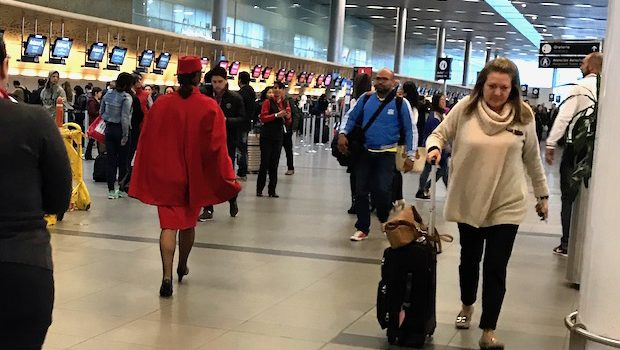 She's got the look: a red-clad Avianca flight attendant.