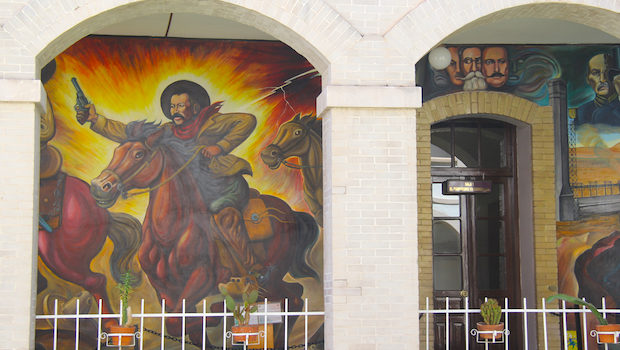 A wall mural decorates the former home of Pancho Villa in Chihuahua, Mexico.