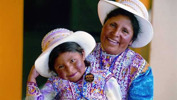 A mother and daughter share smiles in Peru.